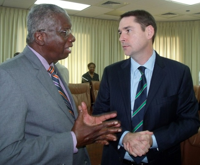 Prime Minister Freundel Stuart and BHP Billiton VP Niall McCormack chatting after signing the agreement.