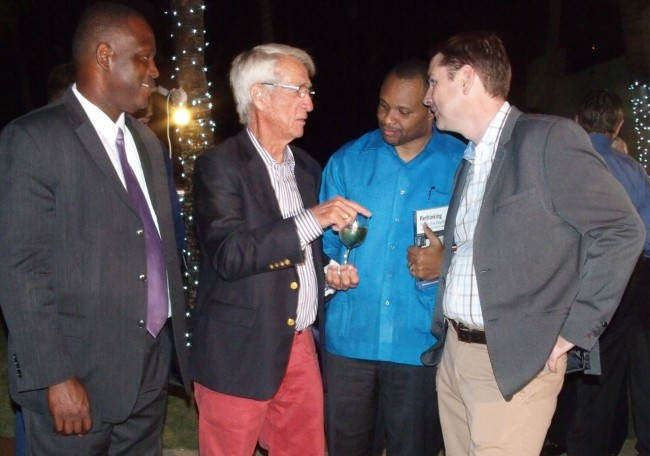 Businessman Sir Charles Williams (second from left) making a point to Minister of Finance  Chris Sinckler (third from left) and BHP vice-president Niall McCormack, as Minister of Industry and Commerce Donville Inniss listens.