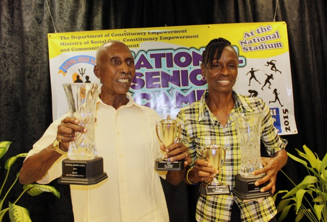 Champion senior athletes Victor Young and Ainsley Lovell are all smiles after collecting their trophies.