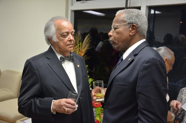 Chancellor Emeritus Sir Shridath Ramphal, left, in conversation with Chancellor Sir George Alleyne.