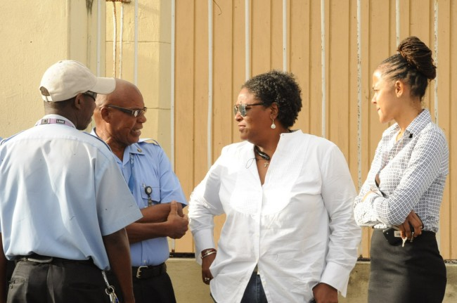 Opposition Leader Mia Mottley (second from left) and Leader of Opposition Business in the House of Assembly Santia Bradshow in conversation with two striking workers.
