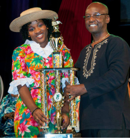 Samantha Sammy G Greaves, 13-to-18 Junior Monarch receiving her trophy from Minister of Culture Stephen Lashley at last year's Finals.