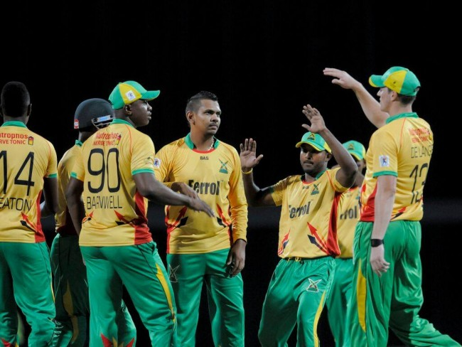 Sunil Narine (centre) is  congratulated by his Warriors' team-mates after dismissing Jonathan  Carter.