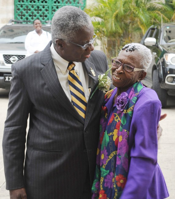 Prime Minister Freundel Stuart speaking to Doriel Green,  one of the elderly members of his St Michael South Constituency,  who came out to support him.