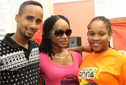 Sir Ruel (left) and Sammy G (right) with a House Of Soca patron.
