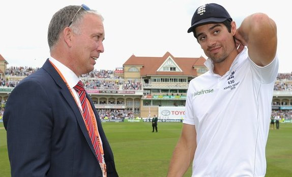 James Whittaker (left) chatting with England captain Alastair Cook.