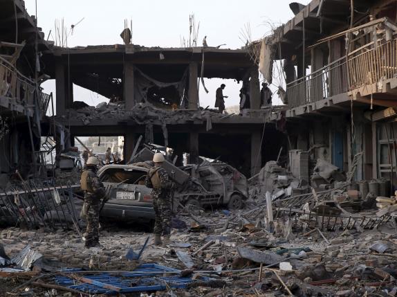 Security personnel keep watch at the site of a truck bomb blast in Kabul, Afghanistan
