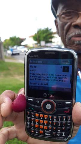 Edinburgh 500 resident Horace Hutson shows a text message he received this morning encouraging him to vote for the UNC candidate for Caroni Central Dr Bhoe Tewarie.