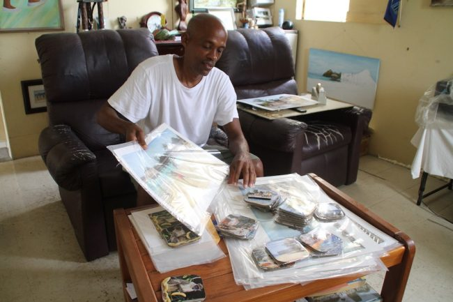 Victor Collector going through some of his prints.