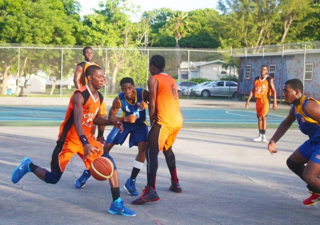Derion Hurley (with ball) of Barbados Community College benefits from a screen set by teammate Karlos Greenidge in order to get past Theo Greenidge of Combermere.