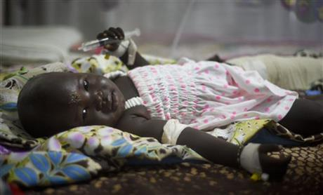 Nyalou Thong, 13 months old and one of only two people who survived yesterday's cargo plane crash, lying in a hospital bed in Juba, South Sudan, today.