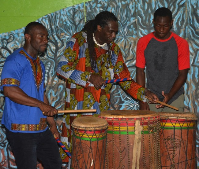 Michael Slocombe (at centre) working the drums with Israel Lovell Foundation members.