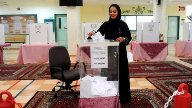 A woman casts her ballot in Jeddah. Some 130,000 women were registered to vote –– a number far below the 1.35m registered male voters.