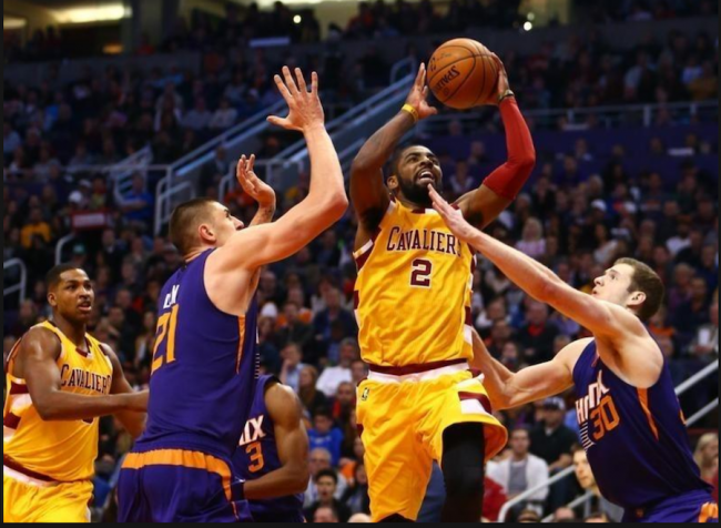 Cavaliers guard Kyrie Irving (with ball) drives to the basket against the Phoenix Suns last night.