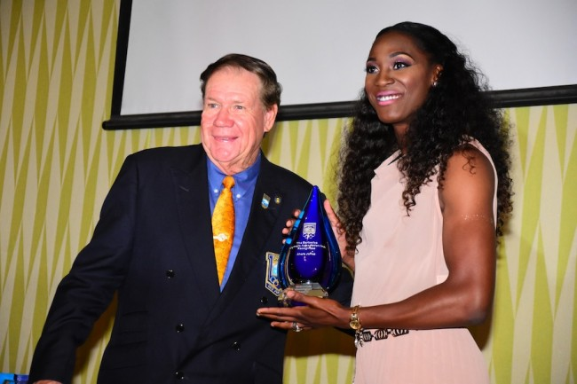 Akela Jones is presented with her award by businessman and BOA vice-president Ralph Johnson.