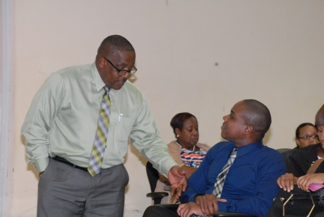 NCC General Manager Keith Neblett (left) chatting with NUPW President Akanni McDowall at yesterday's hearing.