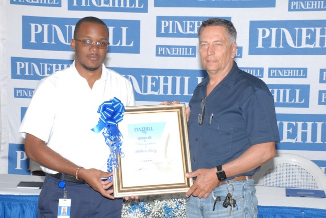 Paul Davis (left) receiving his award for best milk quality from Jeremy Brereton, farm liaison officer at Pine Hill Dairy.