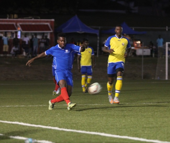 Dwayne Stewart of Empire did well to clear the ball away from Rendezvous dangerman Shandel Samuel.