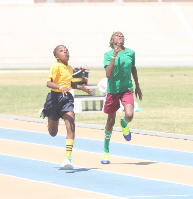 (From left) Victrix ludorum Lanicia Harewood of Yellow House had to contend  with Tamika Husbands of Green House on her shoulders but it was nothing the under-11 queen could not handle.