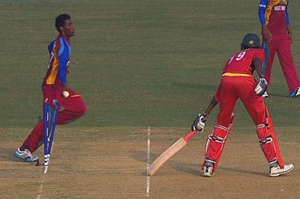 West Indies pacer Kemo Paul effecting a run-out of Zimbabwe's Richard Ngarava.
