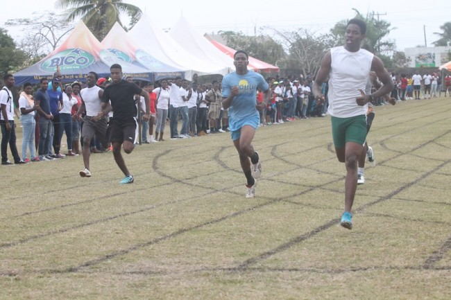 Victor ludorum Josiah Beckles of Set F storms to victory in the senior boys 200m. (Pictures by Morissa Lindsay)