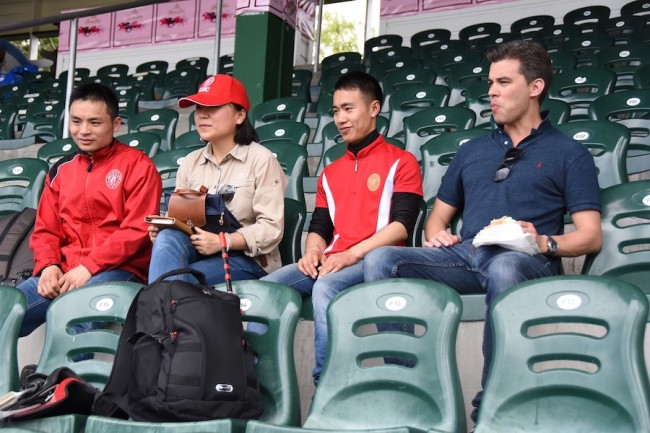 Chinese jockeys Qin Yong and Chen Li taking a breather during the morning session, along with their agent Eden Harrinton. (right).