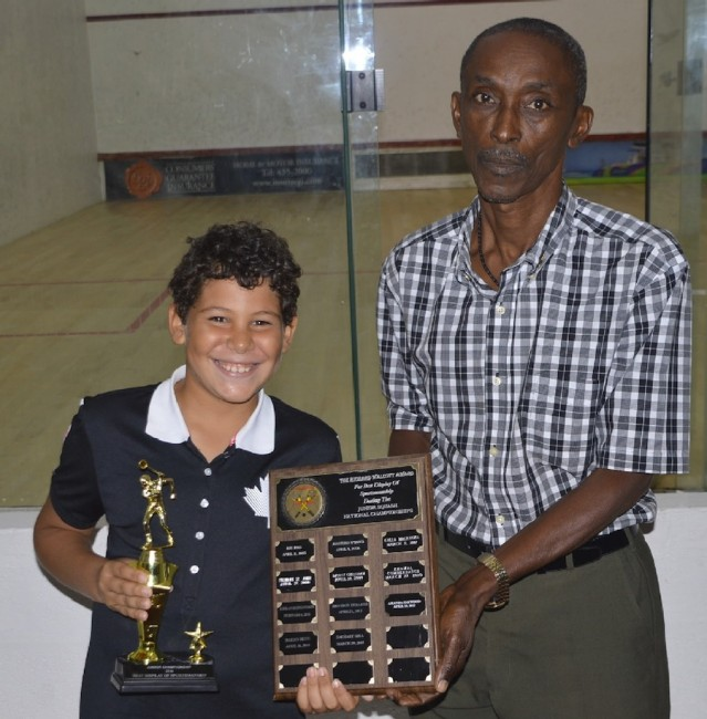 Former national player Richard Walcott presented the Richard Walcott Award for sportsmanship to under-11 champion Alex Stewart (left).(BB)