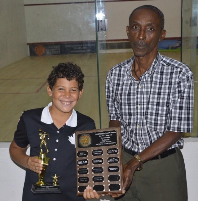 Former national player Richard Walcott presented the Richard Walcott Award for sportsmanship to under-11 champion Alex Stewart (left).(BB)
