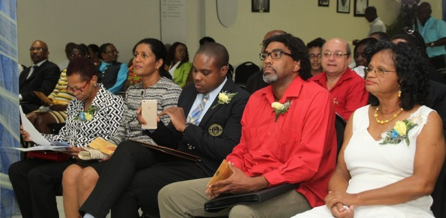 From left front, NUPW acting deputy general secretary Delcia Burke, Minister of Labour Senator Dr Esther Byer-Suckoo, NUPW president  Akanni McDowall, Dr Tennyson Joseph and NUPW general secretary  Roslyn Smith listen attentively to last night's proceedings.