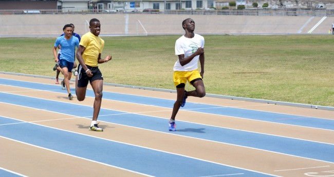 Kuron Griffith cruises home ahead of Jediah Reid in the U20 boys 200m.