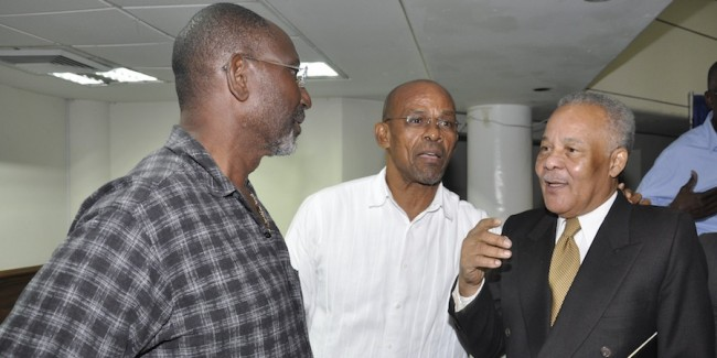 Former Prime Minister Owen Arthur (right) conversing with BCA board member Timothy Boyce (centre) and Dr Leroy McClean.