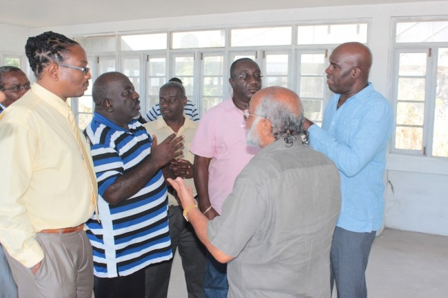 Chairman of the Transport Authority Abdul Pandor (second from right) and Minister of Transport and Works Michael Lashley (right) having a word with (from left) NUPW official Roger Gibson, Morris Lee of APTO, PRO of Alliance Owners of Public Transport Mark Griffith and David Bynoe of APTO.