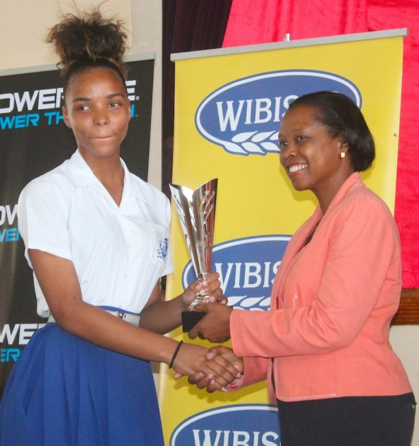 "Kayla Bovell of The Lodge School was presented with a special award for ""making it against the odds"" by Alleyne School principal Julia Beckles."