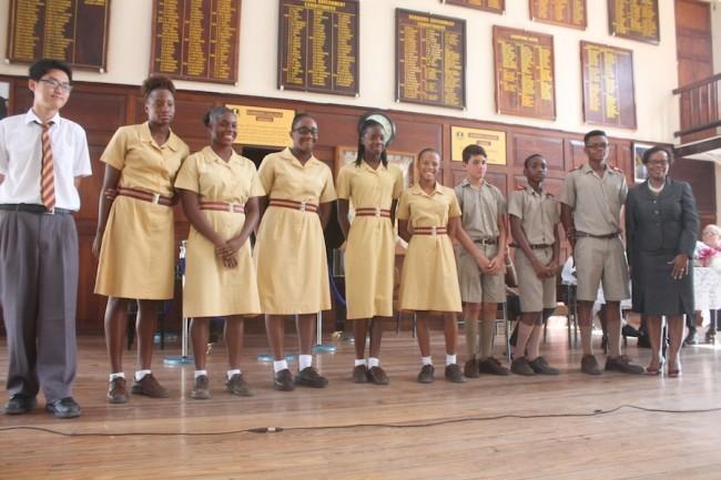 Members of both the CARIFTA swimming and chess team pose with principal Jaunita Wade.