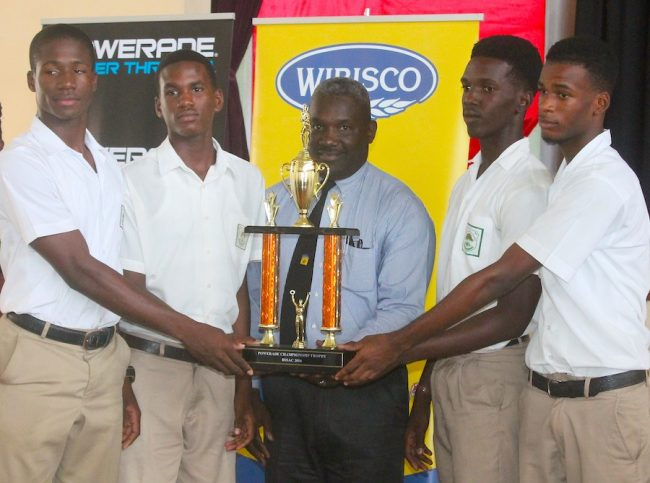 Members of the 2016 champion school, Lester Vaughan, receive their award from Coleridge and Parry principal Vincent Fergusson.