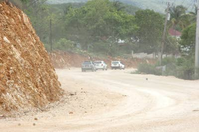 Motorists using the unpaved road on Monday.