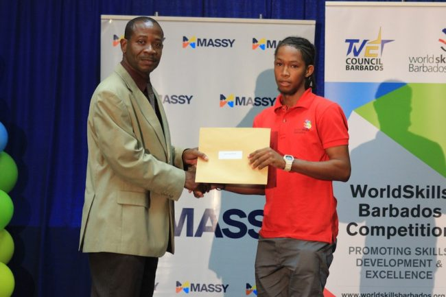 Akeil Craig-Browne (right) is the winner in the automotive arts category. Here he collects his certificate from Executive Director of the TVET Council Henderson Eastmond.