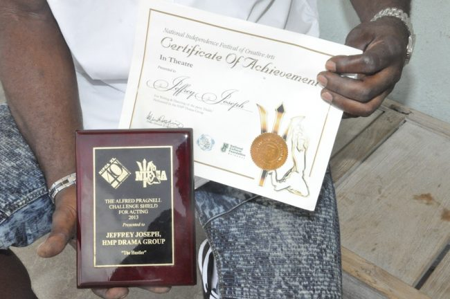 Jeffrey Joseph proudly displays some of the awards he won in prison.