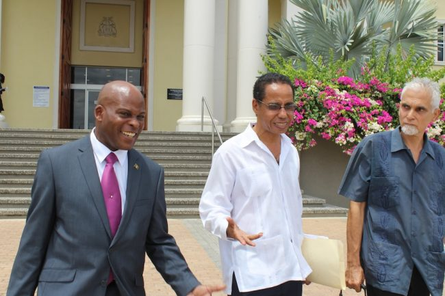 From left, attorneys Edmund Hinkson, David Comissiong and Lalu Hanuman leaving the No 8 Supreme Court today.