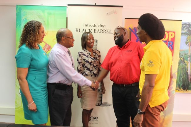National Cultural Foundation CEO Cranston Browne (second from left) shaking the hand of Terry Vaughn, brand manager of Mount  Gay Distilleries, welcoming him back on board, as MQI sales and marketing manager Margaret Hoyte, MQI marketing intern Chenea Waithe and Pic-O-De-Crop producer Adisa Andwele look on.