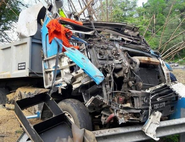 The cab of the dump truck was crushed.