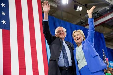 Democratic presidential candidate Hillary Clinton and Senator Bernie Sanders, wave to supporters as Sanders endorsed Clinton during a rally in Portsmouth, New Hampshire.