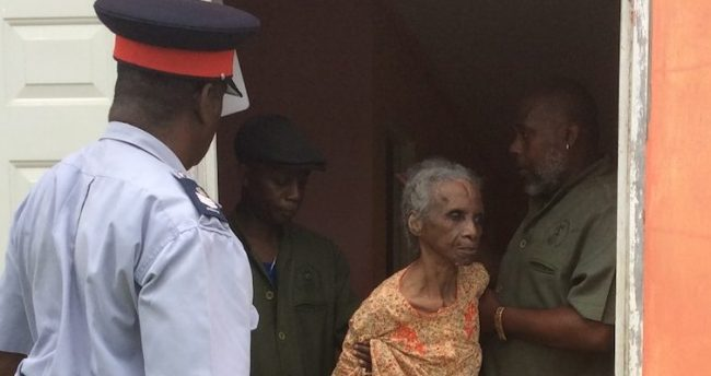 Harriet Codrington being removed from her home by NAB employees this morning.