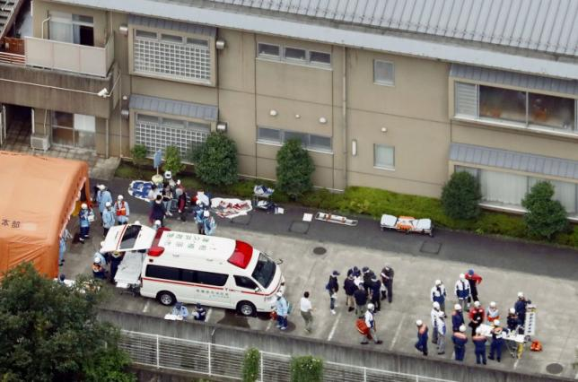 Police officers and rescue workers are seen in a facility for the disabled, where at least 19 people were killed and as many as 20 wounded by a knife-wielding man, in Sagamihara, Kanagawa prefecture, Japan, in this photo taken by Kyodo.