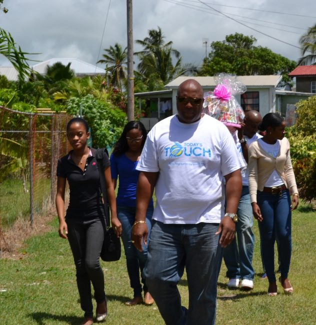 The Barbados TODAY touch team making it's way to Melissa Eastmond's home at Work Hall, St Philip to present her children with gifts.