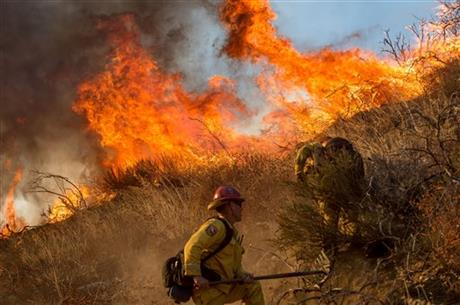 Firefighters battle a wildfire on Cajon Boulevard in Keenbrook, California, on Wednesday.
