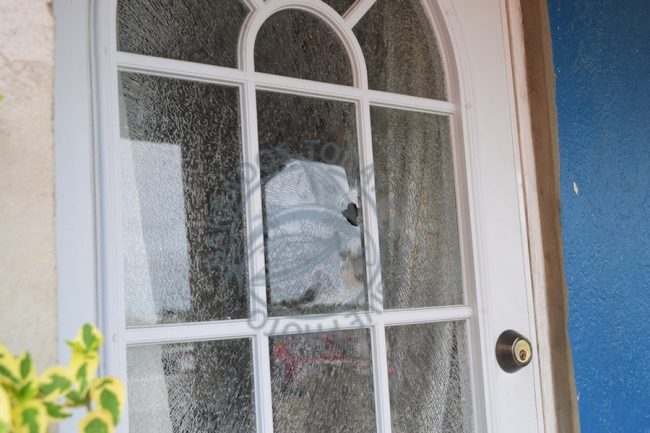 The door of one resident's home that was damaged during the gunplay.