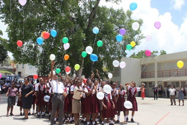 Students of the Seventh-day Adventist Secondary School release their balloons.