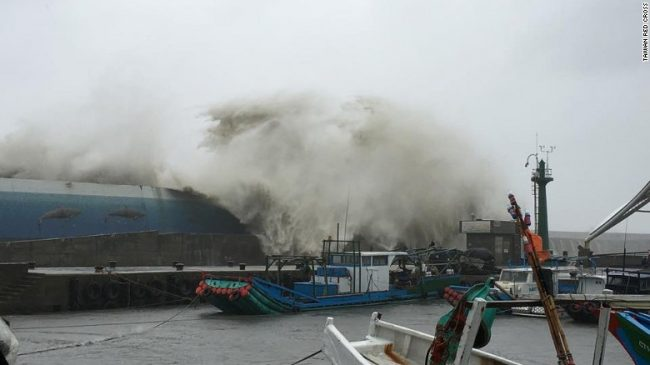 High waves crash over a ship in a fishing port in Taitung county, Taiwan.