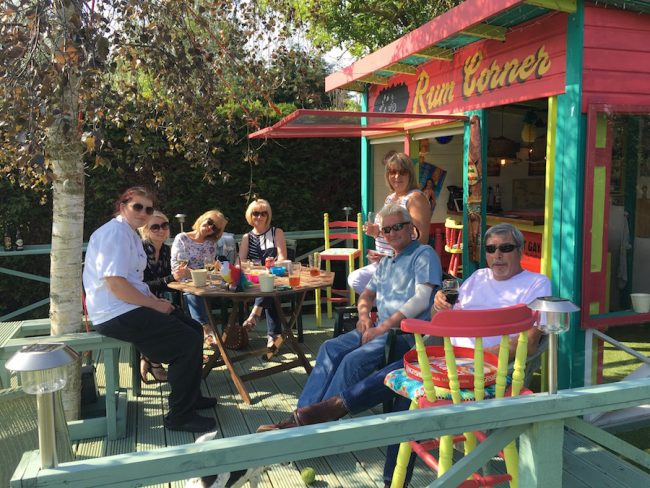 Deborah and Nick Siminson and friends outside their bar built in their garden.